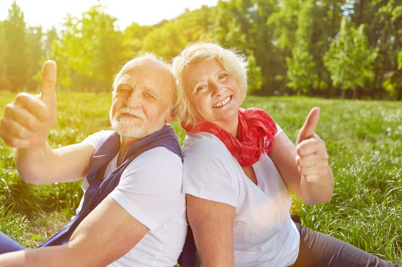 old people giving a thumbs up